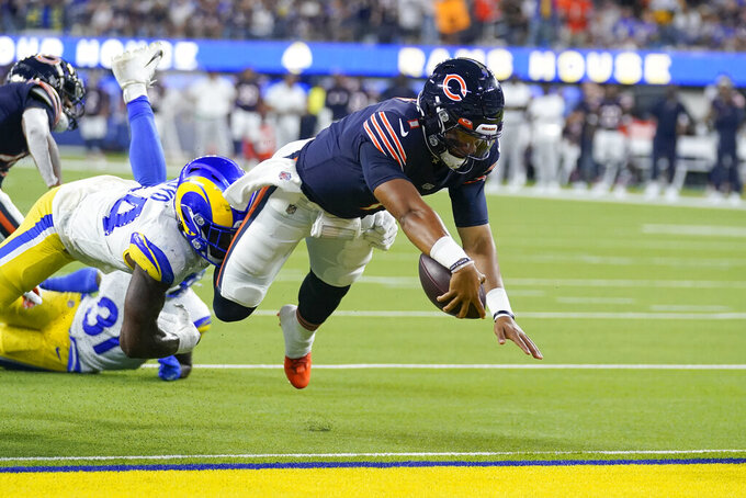 Chicago Bears quarterback Justin Fields scores a touchdown during the second half of an NFL football game against the Los Angeles Rams, Sunday, Sept. 12, 2021, in Inglewood, Calif. (AP Photo/Marcio Jose Sanchez)