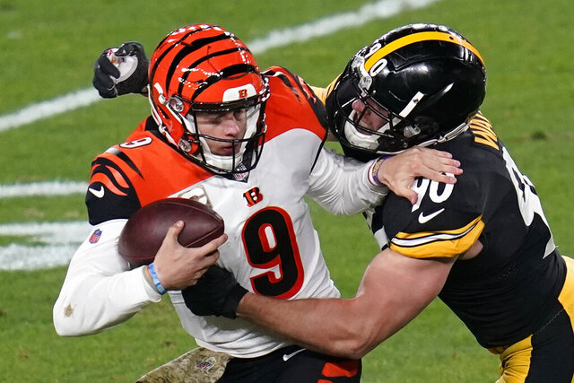 Cincinnati Bengals quarterback Joe Burrow (9) is sacked by Pittsburgh Steelers outside linebacker T.J. Watt (90) during the first half of an NFL football game, Sunday, Nov. 15, 2020, in Pittsburgh. (AP Photo/Keith Srakocic)