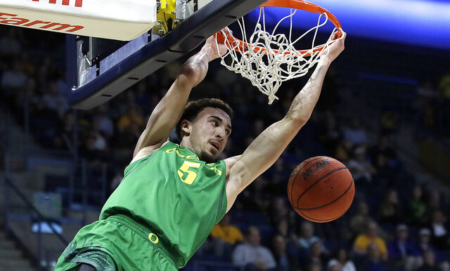 FILE - In this Jan. 30, 2020, file photo, Oregon's Chris Duarte scores against California in the first half of an NCAA college basketball game in Berkeley, Calif. Some three weeks to go before the start of the season, and Oregon hadn't yet scrimmaged. The team was already behind with conditioning. The nonconference scheduling was still being sorted out, in part because of varied COVID-19 regulations and testing protocols among possible opponents. So Oregon, ranked No. 20 in the preseason poll, was trying to stay nimble and healthy. (AP Photo/Ben Margot, File)