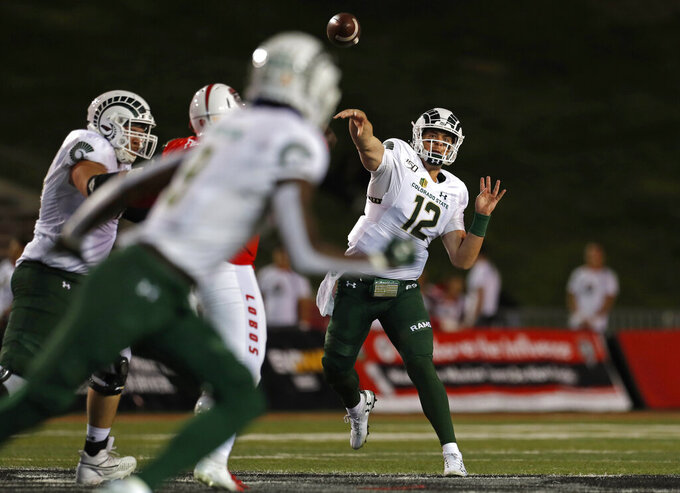 Colorado State quarterback Patrick O'Brien (12) throws a pass intended for wide receiver Warren Jackson (9) during the first half of an NCAA college football game against New Mexico on Friday, Oct. 11, 2019 in Albuquerque, N.M. (AP Photo/Andres Leighton)