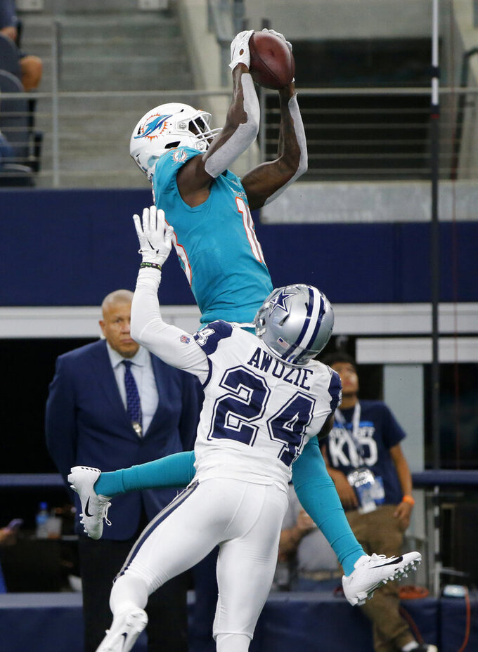 Miami Dolphins wide receiver Preston Williams, top, goes up to catch a pass over Dallas Cowboys cornerback Chidobe Awuzie (24) in the first half of an NFL football game in Arlington, Texas, Sunday, Sept. 22, 2019. (AP Photo/Michael Ainsworth)