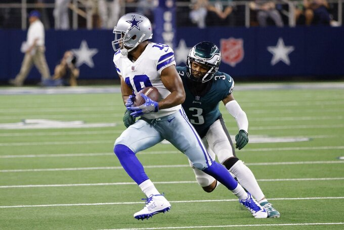Dallas Cowboys wide receiver Amari Cooper (19) catches a pass in front of Philadelphia Eagles cornerback Steven Nelson (3) in the first half of an NFL football game in Arlington, Texas, Monday, Sept. 27, 2021. (AP Photo/Michael Ainsworth)