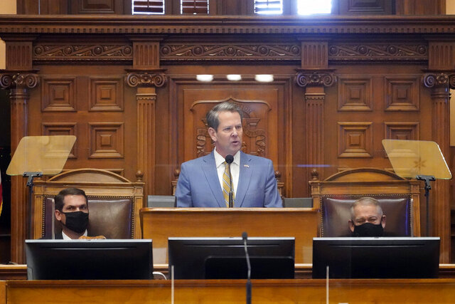 Georgia Gov. Brian Kemp deliveries his State of the State address as Lt. Gov. Geoff Duncan, left, and House Speaker David Ralston look on in the House Chambers Thursday, Jan. 14, 2021, in Atlanta. (AP Photo/John Bazemore)