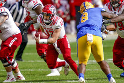 North Carolina State quarterback Devin Leary (13) scrambles for a first down past Pittsburgh defensive lineman Calijah Kancey (8) during the second half of an NCAA college football game, Saturday, Oct. 3, 2020, in Pittsburgh. North Carolina State won 30-29. (AP Photo/Keith Srakocic)