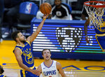 Golden State Warriors guard Stephen Curry (30) drives with the ball past Los Angeles Clippers guard Luke Kennard during the second half of an NBA basketball game in San Francisco, Friday, Jan. 8, 2021. (AP Photo/Tony Avelar)