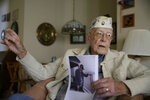 Don Long recalls the 1941 Japanese attack on Hawaii at the same time it took place 77 years ago while sitting in his home Friday, Dec. 7, 2018, in Napa, Calif. Retired U.S. Navy Cmdr. Don Long wasn't at Pearl Harbor when Japanese war planes started bombing Hawaii on December 7, 1941, he was on the opposite side of Oahu standing watch aboard an anchored military seaplane in Kaneohe Bay. But the wave of bombs and bullets reached his military installation soon after Pearl Harbor was struck, and the young sailor watched from afar as buildings and planes started to explode all around him. On the 77th anniversary of the attack, Long will remember from his home where the 97-year-old survivor will reflect and honor those who died.(AP Photo/Eric Risberg)