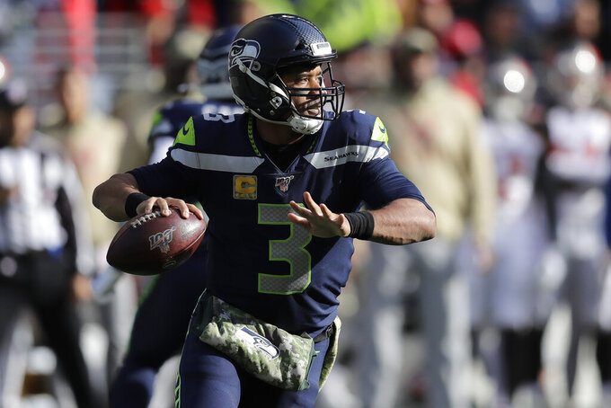 Seattle Seahawks quarterback Russell Wilson looks to pass against the Tampa Bay Buccaneers during the first half of an NFL football game, Sunday, Nov. 3, 2019, in Seattle. (AP Photo/John Froschauer)