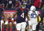 Houston Texans quarterback Deshaun Watson (4) walks off the field after failing to connect on a fourth down against the Indianapolis Colts during the second half of an NFL wild card playoff football game, Saturday, Jan. 5, 2019, in Houston. (AP Photo/Eric Christian Smith)