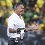 FILE - In this Saturday Sept. 22, 2018, file photo, Oregon coach Mario Cristobal gestures toward his team during the second half of an NCAA college football game against Stanford in Eugene, Ore. If the Pac-12 wants to maximize its already damaged hopes of playing for a national championship No. 7 Washington needs to beat No. 17 Oregon on Saturday.   (AP Photo/Chris Pietsch, File))