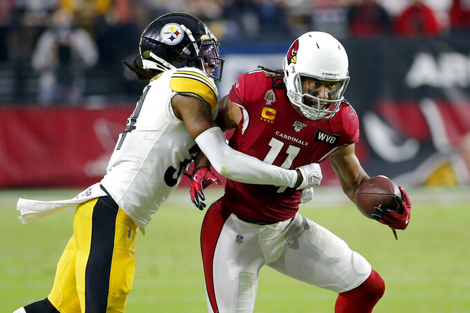 Arizona Cardinals wide receiver Larry Fitzgerald (11) is hit by Pittsburgh Steelers strong safety Terrell Edmunds during the second half of an NFL football game, Sunday, Dec. 8, 2019, in Glendale, Ariz. (AP Photo/Rick Scuteri)