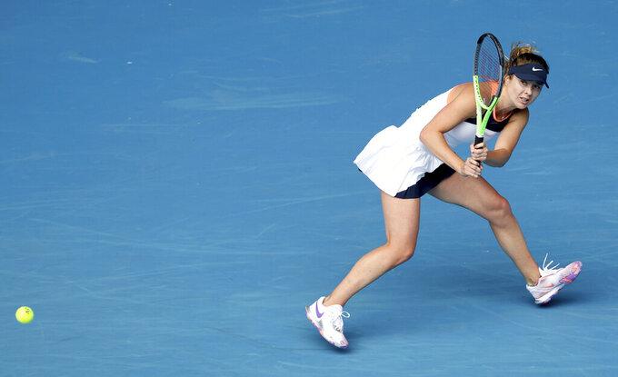 Ukraine's Elina Svitolina hits a backhand to Kazakhstan's Yulia Putintseva during their third round match at the Australian Open tennis championships in Melbourne, Australia, Saturday, Feb. 13, 2021. (AP Photo/Hamish Blair)