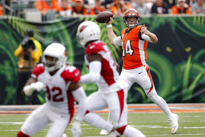 Cincinnati Bengals quarterback Andy Dalton (14) passes in the first half of an NFL football game against the Arizona Cardinals, Sunday, Oct. 6, 2019, in Cincinnati. (AP Photo/Gary Landers)