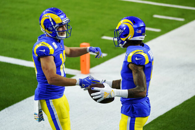 Los Angeles Rams wide receiver Josh Reynolds, right, celebrates his touchdown catch with Cooper Kupp during the first half of an NFL football game against the Chicago Bears Monday, Oct. 26, 2020, in Inglewood, Calif. (AP Photo/Ashley Landis)