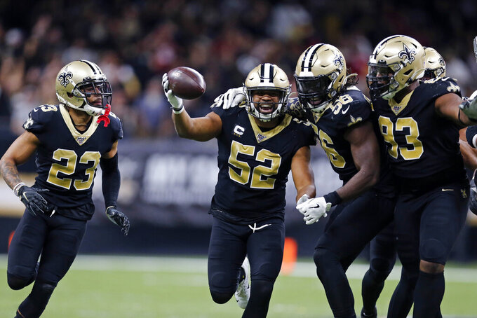 New Orleans Saints linebacker Craig Robertson (52) celebrates his interception in the second half an NFL football game against the San Francisco 49ers in New Orleans, Sunday, Dec. 8, 2019. (AP Photo/Brett Duke)