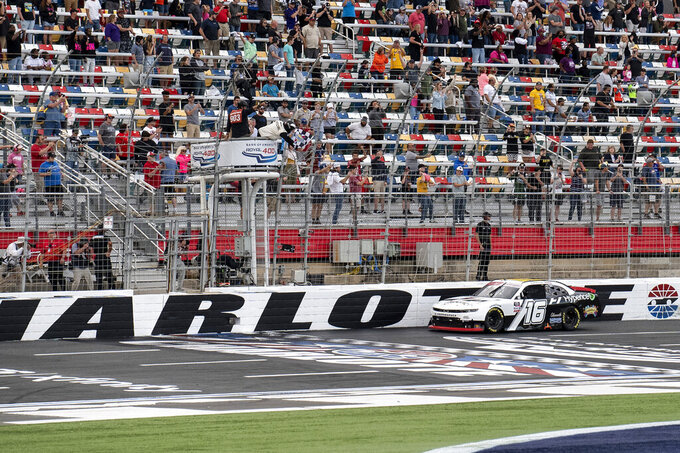 NASCAR Xfinity Series driver AJ Allmendinger (16) takes the checkered flag to win the NASCAR Xfinity auto race at the Charlotte Motor Speedway Saturday, Oct. 9, 2021, in Concord, N.C. (AP Photo/Matt Kelley)