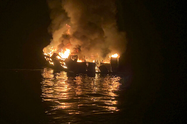 FILE - In this Sept. 2, 2019, file photo provided by the Santa Barbara County Fire Department, the dive boat Conception is engulfed in flames after a deadly fire broke out aboard the commercial scuba diving vessel off the Southern California Coast. Federal authorities are expected to vote Tuesday, Oct. 20, 2020 on what likely sparked a fire aboard a scuba dive boat last year that killed 34 people off the coast of Southern California. The pre-dawn blaze aboard the Conception is one of California's deadliest maritime disasters, prompting both criminal and safety investigations into the Sept. 2, 2019 tragedy that claimed the lives of 33 passengers and one crew member on a Labor Day weekend expedition near an island off Santa Barbara. (Santa Barbara County Fire Department via AP, File)