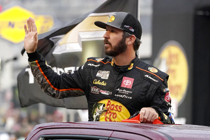 Pole position winner Martin Truex Jr. waves to fans as he is introduced before a NASCAR Cup Series auto race at Bristol Motor Speedway Saturday, Sept. 18, 2021, in Bristol, Tenn. (AP Photo/Mark Humphrey)