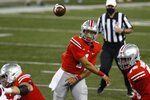 Ohio State quarterback Justin Fields throws a pass against Rutgers during the first half of an NCAA college football game Saturday, Nov. 7, 2020, in Columbus, Ohio. (AP Photo/Jay LaPrete)