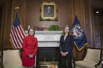 Judge Amy Coney Barrett, President Donald Trumps nominee for the U.S. Supreme Court, meets with Sen. Shelley Moore Capito, R-W.Va., on Capitol Hill in Washington, Wednesday, Sept. 30, . (Sarah Silbiger/Pool via AP)