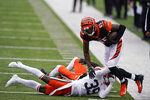 Cincinnati Bengals' Tee Higgins (85) is tackled by Cleveland Browns' Terrance Mitchell (39) during the second half of an NFL football game, Sunday, Oct. 25, 2020, in Cincinnati. (AP Photo/Bryan Woolston)