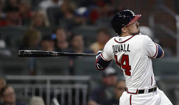 Atlanta Braves' Adam Duvall watches his home run against the Washington National during the eighth inning of a baseball game Thursday, Sept. 9, 2021, in Atlanta. (AP Photo/Ben Margot)