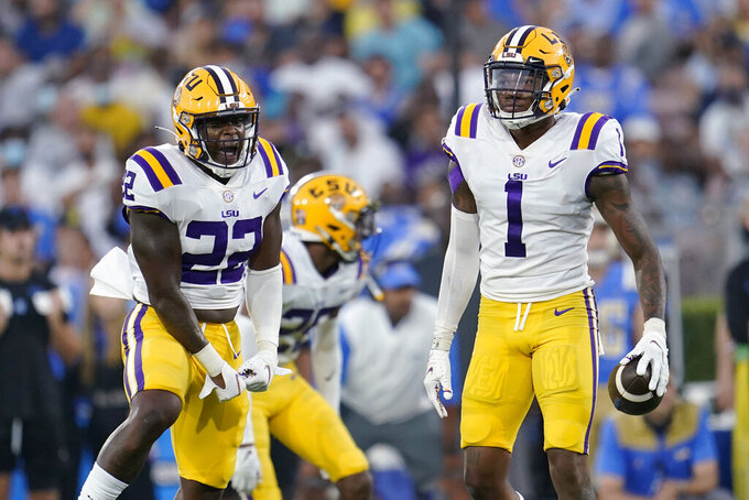 LSU cornerback Eli Ricks (1) holds the ball after intercepting a UCLA pass during the first half of an NCAA college football game Saturday, Sept. 4, 2021, in Pasadena, Calif. (AP Photo/Marcio Jose Sanchez)