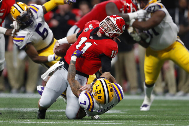 LSU safety Grant Delpit (7) sacks Georgia quarterback Jake Fromm (11) during the first half of the Southeastern Conference championship NCAA college football game, Saturday, Dec. 7, 2019, in Atlanta. Fromm was injured on the play. (AP Photo/John Bazemore)