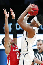 Richmond guard Nick Sherod (5) shoots over Wisconsin guard D'Mitrik Trice (0) during the first half of an NCAA college basketball game in the Legends Classic, Monday, Nov. 25, 2019, in New York. (AP Photo/Kathy Willens)