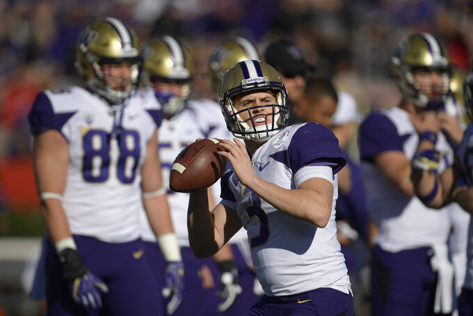 Washington quarterback Jake Browning warms up before the Rose Bowl NCAA college football game against Ohio State Tuesday, Jan. 1, 2019, in Pasadena, Calif. (AP Photo/Mark J. Terrill)