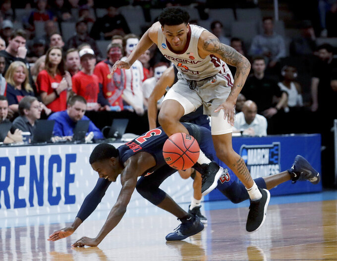 Virginia Tech guard Nickeil Alexander-Walker, top, vies for a loose ball with Liberty guard Lovell Cabbil Jr. with during the second half of a second-round game in the NCAA men's college basketball tournament Sunday, March 24, 2019, in San Jose, Calif. (AP Photo/Jeff Chiu)