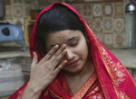 FILE - In this April 14, 2019 file photo, Pakistani Christian Mahek Liaqat, who married a Chinese national, cries as she narrates her ordeal, in Gujranwala, Pakistan. The Associated Press has obtained a list, compiled by Pakistani investigators determined to break up trafficking networks, that identifies hundreds of girls and women from across Pakistan who were sold as brides to Chinese men and taken to China. Christians are targeted because they are one of the poorest communities in Muslim-majority Pakistan. (AP Photo/K.M. Chaudary, File)