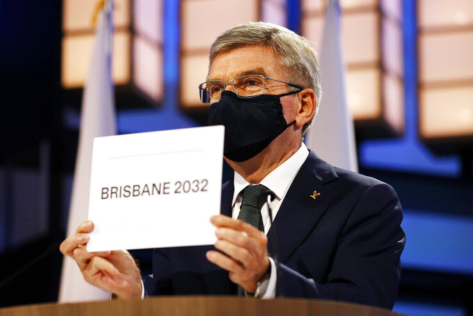 President of the International Olympic Committee Thomas Bach announces Brisbane as the 2032 Summer Olympics host city during the 138th IOC Session at Hotel Okura in Tokyo, Wednesday, July 21, 2021. (Toru Hanai/Pool Photo via AP)