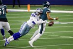 Philadelphia Eagles quarterback Jalen Hurts (2) fumbles the ball as he's sacked by Dallas Cowboys defensive end Randy Gregory (94) in the second half of an NFL football game in Arlington, Texas, Sunday, Dec. 27. 2020. The Eagles recovered the fumble. (AP Photo/Ron Jenkins)