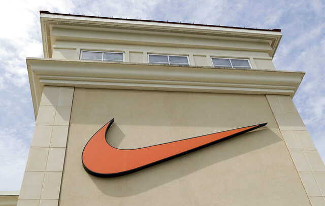 FILE - In this file photo dated Tuesday, Sept. 4, 2018, a Nike company logo is displayed outside a Nike store in Charlotte, N.C. Nike appears to have recovered from its pandemic slump, posting a solid quarterly profit driven by soaring online sales of its sneakers and workout apparel. The world's largest sports apparel maker on Tuesday, Sept. 22, 2020 reported a net profit of $1.5 billion profit, or 95 cents per share, in the three-month period ending Aug. 31, up 11% from the same 2019 quarter. (AP Photo/Chuck Burton, file)