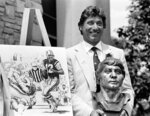FILE - In this Aug. 3, 1985, file photo, former New York Jets quarterback Joe Namath poses with a bronze bust of himself after his induction into the Pro Football Hall of Fame in Canton, Ohio. Broadway Joe was the No. 1 overall pick in the AFL draft in 1965 and went on to deliver the franchise its only Super Bowl victory - and still its only appearance in the big game. (AP Photo/Ernie Mastroianni, File)