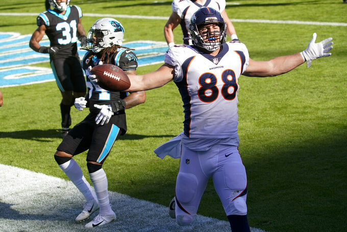 Denver Broncos tight end Nick Vannett celebrates after scoring against the Carolina Panthers during the first half of an NFL football game Sunday, Dec. 13, 2020, in Charlotte, N.C. (AP Photo/Brian Blanco)