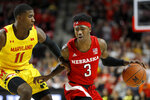 Nebraska guard Cam Mack (3) drives against Maryland guard Darryl Morsell (11) during the first half of an NCAA college basketball game, Tuesday, Feb. 11, 2020, in College Park, Md. (AP Photo/Julio Cortez)