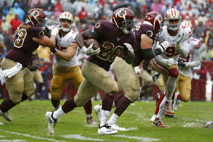 Washington Redskins running back Adrian Peterson (26) rushes the ball in the second half of an NFL football game against the San Francisco 49ers, Sunday, Oct. 20, 2019, in Landover, Md. (AP Photo/Alex Brandon)