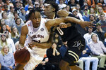 Auburn forward Isaac Okoro (23) drives past Vanderbilt guard Saben Lee (0) during the second half of an NCAA college basketball game Wednesday, Jan. 8, 2020, in Auburn, Ala. (AP Photo/Julie Bennett)