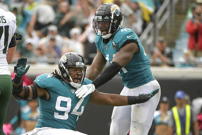 Jacksonville Jaguars defensive end Dawuane Smoot (94) celebrates after sacking New York Jets quarterback Sam Darnold during the first half of an NFL football game, Sunday, Oct. 27, 2019, in Jacksonville, Fla. (AP Photo/Phelan M. Ebenhack)