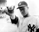 FILE - In this Oct. 14, 1964 file photo, New York Yankees pitcher Jim Bouton takes aim as he holds two balls in the right hand that his teammates hope will lead them to victory in the sixth World Series game in New York. Jim Bouton, the New York Yankees pitcher who shocked the conservative baseball world with the tell-all book