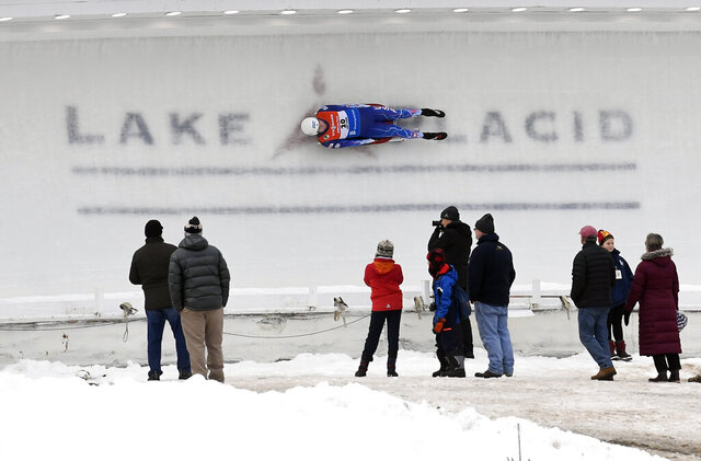 FILE - In this Dec. 15, 2018, file photo, Tucker West competes in the men's luge World Cup event in Lake Placid, N.Y. Lake Placid will not play host to any major international sliding events this winter, after the International Luge Federation said Wednesday, Sept. 16, 2020,  it will not hold a World Cup competition there because of concerns about the coronavirus pandemic. The upstate New York village was supposed to host a luge World Cup in mid-January. It will now be held in Oberhof, Germany, meaning the entire sliding-sports season will be held in Europe and Asia — skipping North America entirely.(AP Photo/Hans Pennink, File)