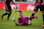 Inter Miami goalkeeper Nick Marsman, center, dives to deflect a shot during the first half of an MLS soccer match against the New York Red Bulls, Friday, Sept. 17, 2021, in Fort Lauderdale, Fla. (AP Photo/Rebecca Blackwell)