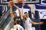 Gonzaga forward Drew Timme, left rear, grabs a rebound as BYU forward Yoeli Childs (23) reaches for it during the first half of an NCAA college basketball game Saturday, Feb. 22, 2020, in Provo, Utah. (AP Photo/Rick Bowmer)
