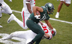 Michigan State running back Connor Heyward (11) stiff arms Ohio State linebacker Pete Werner during the first half of an NCAA college football game, Saturday, Dec. 5, 2020, in East Lansing, Mich. (AP Photo/Al Goldis)