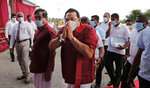 Sri Lankan Prime Minister and older brother of the country's current president Mahinda Rajapaksa, center, greets supporters during an election rally in Colombo, Sri Lanka, July 22, 2020. Sri Lankans are voting Aug. 5 in parliamentary elections that are expected to strengthen President Gotabaya Rajapaksa's grip on power. More than 16 million people are eligible to vote to elect 196 out of a total of 225 lawmakers. The others will be named from a national list according to the number of votes received by each party or independent group. (AP Photo/Eranga Jayawardena)