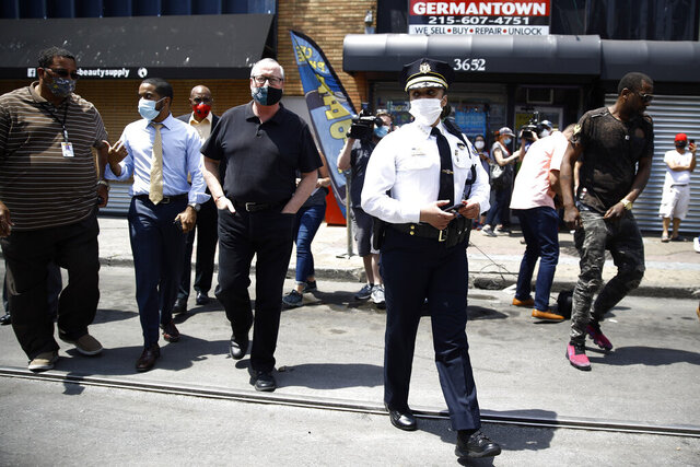 Philadelphia Police Commissioner Danielle Outlaw, center, and Mayor Jim Kenney, 4th left, meet with people, Thursday, June 4, 2020, in Philadelphia after days of protest over the May 25 death of George Floyd, who died after being restrained by police in Minneapolis. (AP Photo/Matt Rourke)