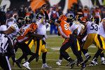 Pittsburgh Steelers quarterback Ben Roethlisberger (7) is hit as he throws during the second half of an NFL football game against the Cincinnati Bengals, Monday, Dec. 21, 2020, in Cincinnati. (AP Photo/Bryan Woolston)