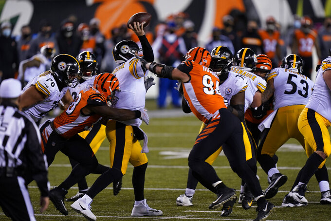 Pittsburgh Steelers quarterback Ben Roethlisberger (7) is hit as he throws during the second half of an NFL football game against the Cincinnati Bengals, Monday, Dec. 21, 2020, in Cincinnati. (AP Photo/Bryan Woolston)