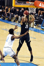 Colorado forward Evan Battey (21) shoots over UCLA forward Cody Riley (2) during the first half of an NCAA college basketball game Saturday, Jan. 2, 2021, in Los Angeles. (AP Photo/Marcio Jose Sanchez)